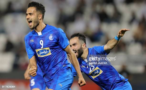 Esteghlal FC's Iranian forward Ali Ghorbani celebrates with his teammates after scoring a goal against AlRayyan SC during their Asian Champions...