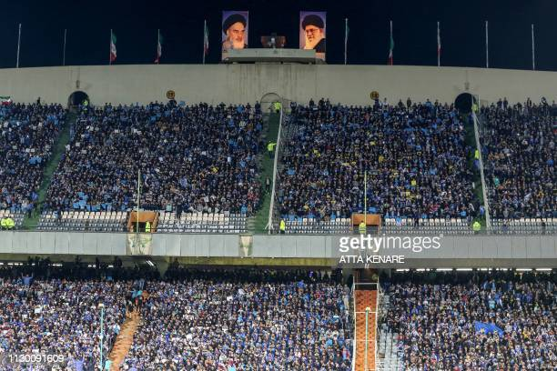 Esteghlal's fans cheer for their team during the AFC champions league Group C football match between Iran's Esteghlal and UAE's Al Ain at the Azadi...