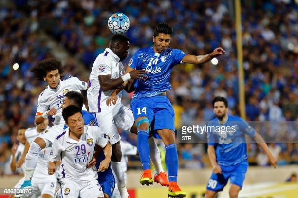 Esteghlal's Farshid Bagheri fights for the ball agaisn alAin's Saeed Juma during the 2017 AFC Champions League round 16 football match between Iran's...