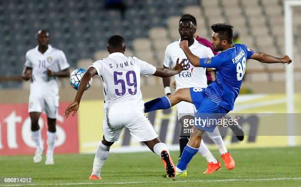 Esteghlal's Farshid Esmaieli fights for the ball agaisn alAin's Saeed Juma during the 2017 AFC Champions League round 16 football match between...