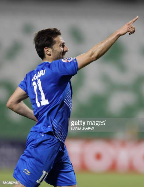 Esteghlal's forward Jaber Ansari celebrates after scoring a goal during their Asian Champions League football match between Iran's Esteghlal FC and...