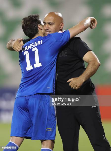 Esteghlal's forward Jaber Ansari celebrates with the team's Iranian head coach Alireza Mansourian after scoring a goal during their Asian Champions...