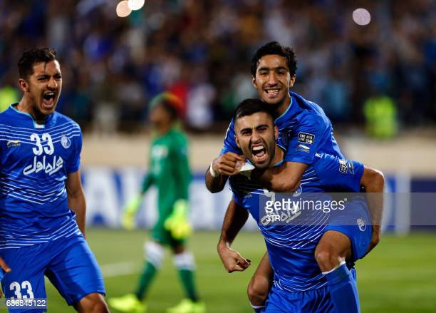 Esteghlal's Kaveh Rezaie celebrates with his teammates after scoring during the 2017 AFC Champions League round 16 football match between Iran's...