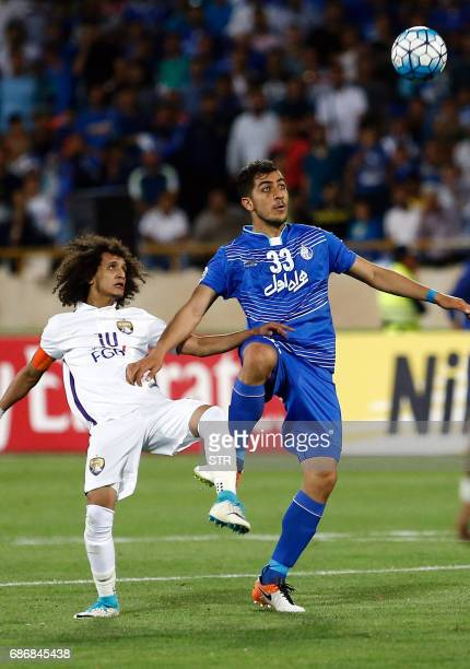 Esteghlal's Majid Hosseini in action against AlAin's Omar Abdulrahman during the 2017 AFC Champions League round 16 football match between Iran's...