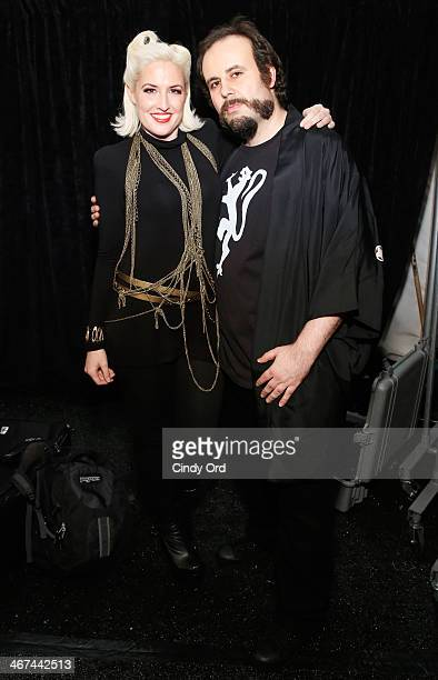 Estel Day and Mark Tango prepare backstage at the Mark And Estel fashion show during Mercedes-Benz Fashion Week Fall 2014 at The Salon at Lincoln...