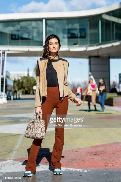 Estela Grande wears Adidas trainers ZARA sweater and trousers and MANGO jacket and handbag during the Mercedes Benz Fashion Week Madrid Autumn/Winter...