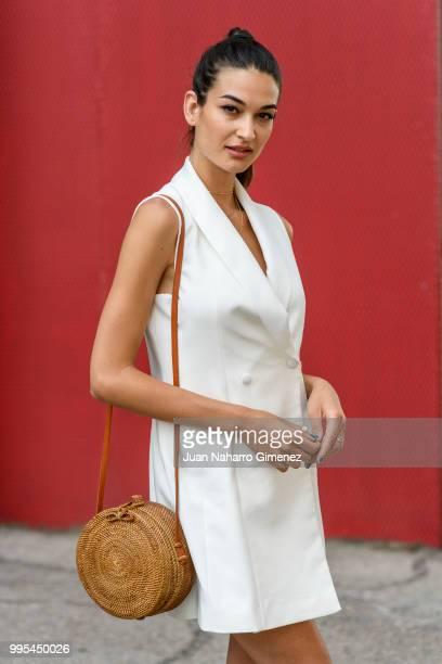 Estela Grande wears Yves Saint Laurent shoes Zara dress and Gota de Agua handbag during the Mercedes Benz Fashion Week Spring/Summer 2019 at IFEMA on...