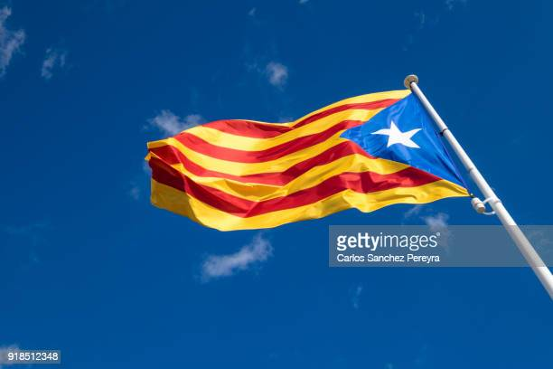 estelada flag of catalonia in costa brava spain - catalonia stock pictures, royalty-free photos & images