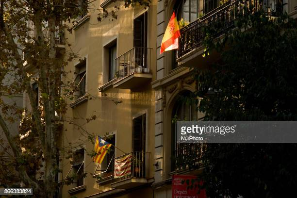A estelada or proindependence flag and a Spanish flag hang side by side in balconys of Barcelona Spain on 25 October 2017 Spanish government aims to...