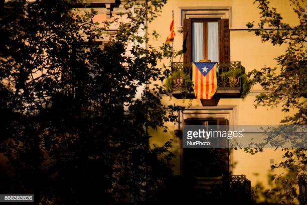 A estelada or proindependence flag hangs from a balcony in Barcelona Spain on 25 October 2017 Spanish government aims to apply constitution article...