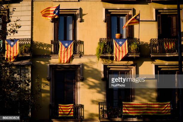 Estelada or proindependence flags hang in balconys of Barcelona Spain on 25 October 2017 Spanish government aims to apply constitution article 155...