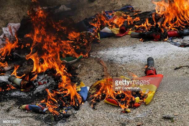 'Esteladas' Catalan proindependence flags burn during an ultraright wing antiseparatist demonstration for the unity of Spain called by 'Falange...