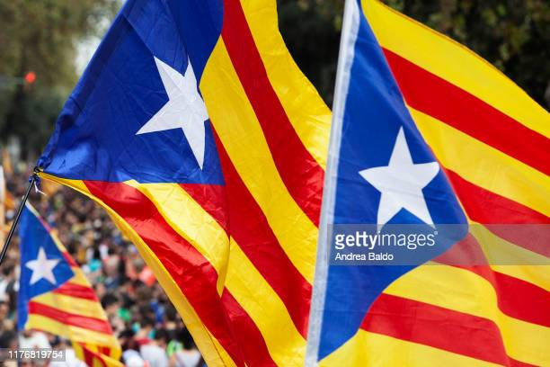 Esteladas flags is waved by Catalonian independence supporters taking part in a massive demonstration of over a million of people in the streets of...