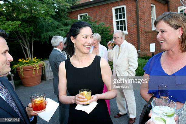 Estella Chung curator and oral historian at Hillwood Estate Museum and Gardens center speaks with unidentified guests during a dinner party at the...