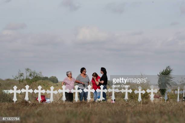 Estella McAteer her daughter Diana Gaitan Maria Durand and her daughter Lupita Alcoces visit a memorial where 26 crosses stand in a field on the edge...