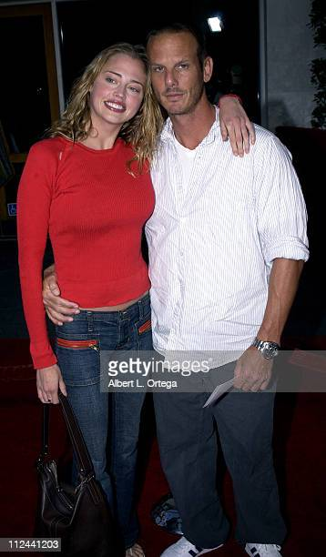 Estella Warren and Peter Berg during 'American Wedding' Premiere in Universal City California United States