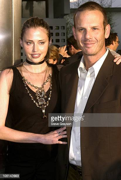 Estella Warren and Peter Berg during The Cooler Premiere Red Carpet Arrivals at The Arclight Dome in Hollywood California United States