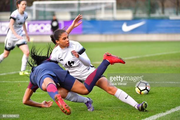 Estelle Cascarino of Paris FC conceeds a penalty for a foul on Marie Antoinette Katoto of PSG during the Women's Division 1 match between Paris Saint...