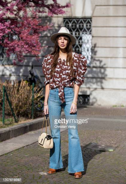 Estelle Chemouny is seen wearing brown white blouse flared denim jeans white hat YSL bag brown boots outside Pucci during Milan Fashion Week...