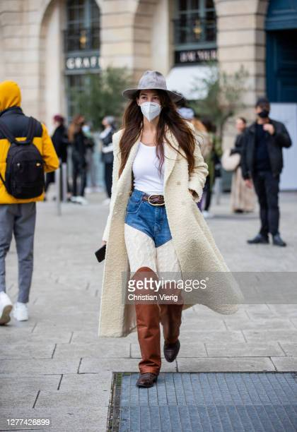 Estelle Chemouny seen wearing teddy coat, hat, two tone denim jeans, brown boots outside Victoria/Tomas during Paris Fashion Week - Womenswear Spring...