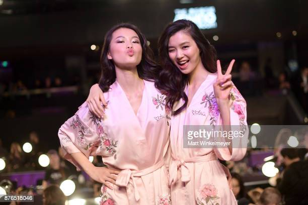 Estelle Chen and Liu Wen pose in Hair Makeup during 2017 Victoria's Secret Fashion Show In Shanghai at MercedesBenz Arena on November 20 2017 in...