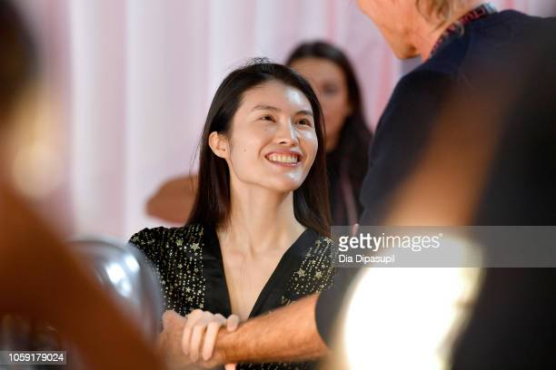 Estelle Chen prepares backstage during 2018 Victoria's Secret Fashion Show in New York at Pier 94 on November 8 2018 in New York City