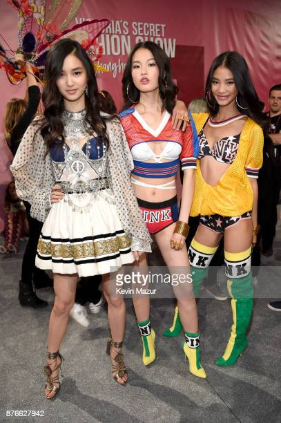 Estelle Chen Xin Xie and One Wang backstage during 2017 Victoria's Secret Fashion Show In Shanghai at MercedesBenz Arena on November 20 2017 in...