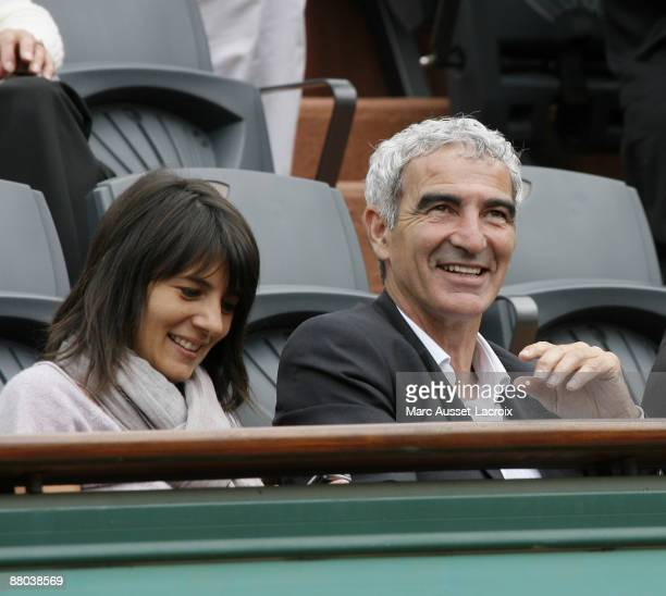 Estelle Denis and Raymond Domenech attend the second round match between Switzerland's Roger Federer and Argentina's Jose Acasuso at the French Open...