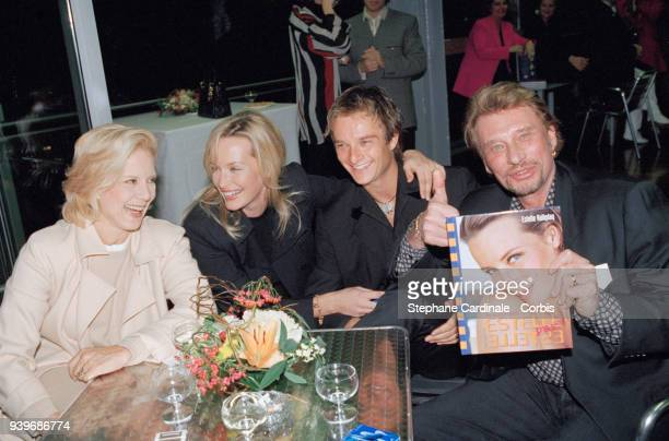 Estelle Hallyday book launch - From left to right : French singer Sylvie Vartan, Estelle Hallyday with her husband David Hallyday, french singer Johnny Hallyday celebrating, 13th November 1997