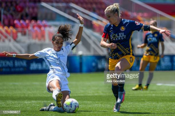 Estelle Johnson of Sky Blue FC slides into Amy Rodriguez of Utah Royals FC during a game on day 4 of the NWSL Challenge Cup at Zions Bank Stadium on...