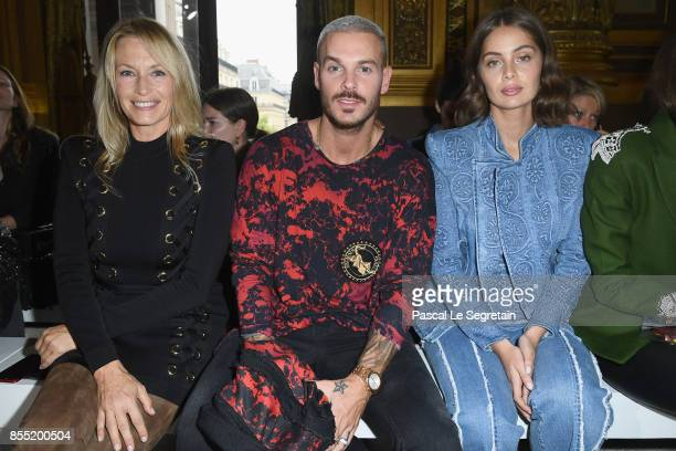 Estelle Lefebure Matt Pokora and MarieAnge Casta attend the Balmain show as part of the Paris Fashion Week Womenswear Spring/Summer 2018 on September...
