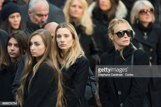 Estelle Lefebure with her daughters Ilona Smet and Emma Hallyday leave the church after Johnny Hallyday's Funeral at Eglise De La Madeleine on...