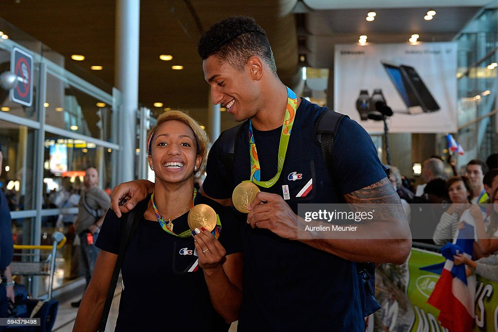 Estelle Mossely, light 60kg boxing Gold medalist and Tony Yoka, super heavy over 91kg gold medalist, arrive at Roissy Charles de Gaulle airport after the Olympic Games in Rio on August 23, 2016 in Paris, France. Team France finished seventh in the medal table at the Rio Olympics, with a total of 42 medals.
