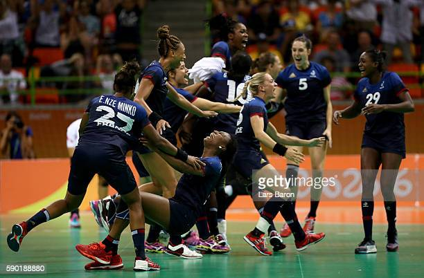 Estelle NzeMinko of France and Siraba Dembele of France celebrate with their team mates after winning the Womens Quarterfinal match between Spain and...