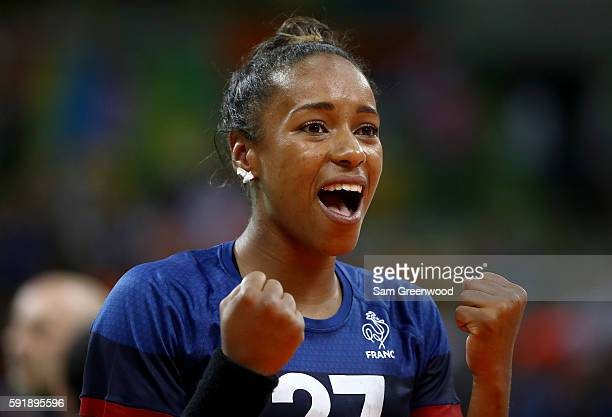 Estelle Nze-Minko of France celebrates a victory over the Netherlands during the Women's Handball Semi-final at the Future Arena on Day 13 of the...