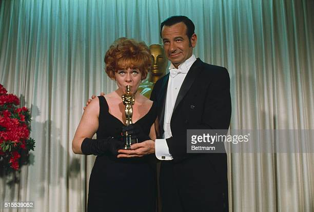 Estelle Parsons is shown with Walter Matthau, who presented her with an Oscar for Best supporting Actress, during the annual Academy Awards...