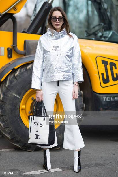 Estelle Pigault poses wearing a Courreges top and a Chanel bag after the Beautiful People show at the Preau Dutuit during Paris Fashion Week...