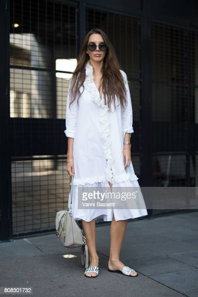 Estelle Pigault poses withe a Chloe bag and Dior slippers before the Stephane Rolland show at the Opera Bastille during Paris Fashion Week Haute...