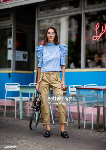 Estelle Pigault wearing blue ruffled top beige pants is seen outside Dion Lee during New York Fashion Week Spring/Summer 2019 on September 8 2018 in...