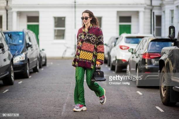 Estelle Pigault wearing Etro coat green palazzo pants Herems mini bag Balenciaga sneakers Ray Ban sunglasses during London Fashion Week Men's January...