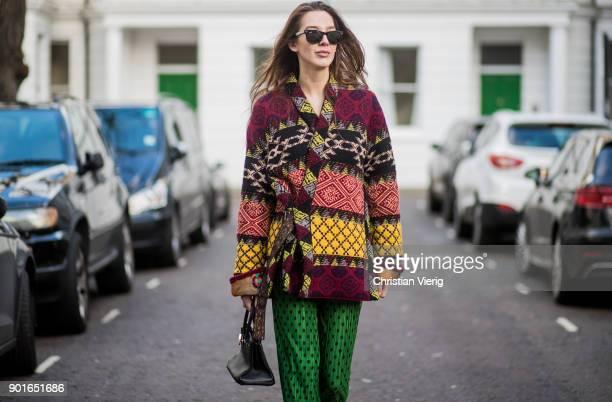 Estelle Pigault wearing Etro coat green palazzo pants Herems mini bag Balenciaga sneakers Ray Ban sunglasses during London Fashion Week Men's January...