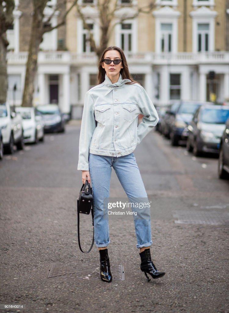 Estelle Pigault wearing light blue Balenciaga denim jacket, cropped vintage denim jeans, black Saint Laurent boots, Balenciaga bag during London Fashion Week Men's January 2018 on January 5, 2018 in London, England.