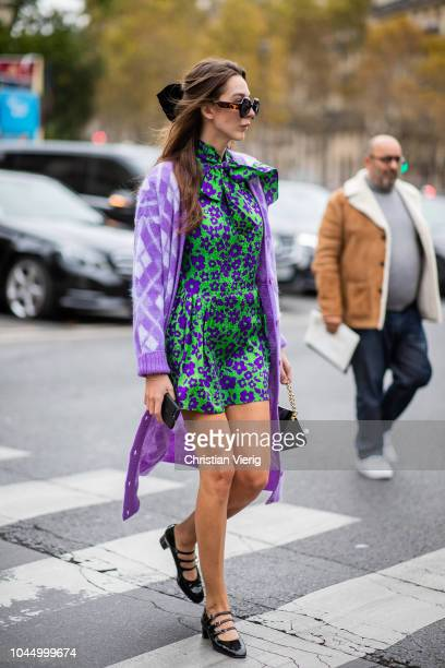 Estelle Pigault wearing purple kimono cardigan green dress is seen outside Miu Miu during Paris Fashion Week Womenswear Spring/Summer 2019 on October...
