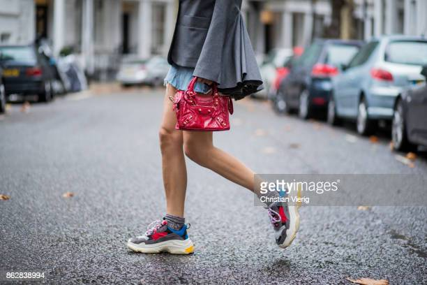 Estelle Pigault wearing vintage denim mini skirt a grey blazer with wide sleeves Milo Maria red Balenciaga mini bag Balenciaga Triple S sneakers on...