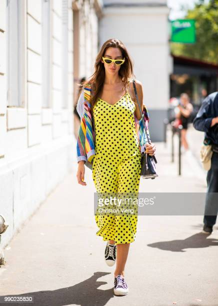 Estelle Pigault wearing yellow dress with dots print jacket seen outside Dior on day two during Paris Fashion Week Haute Couture FW18 on July 2 2018...