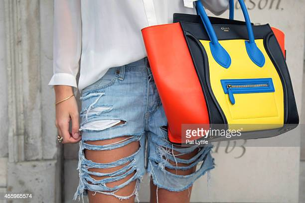 Estelle Pigeou from france spotted on day 2 of London Fashion Week SS 2015 wears a Celine Boston bag shirt by Primark and shorts by HM on September...