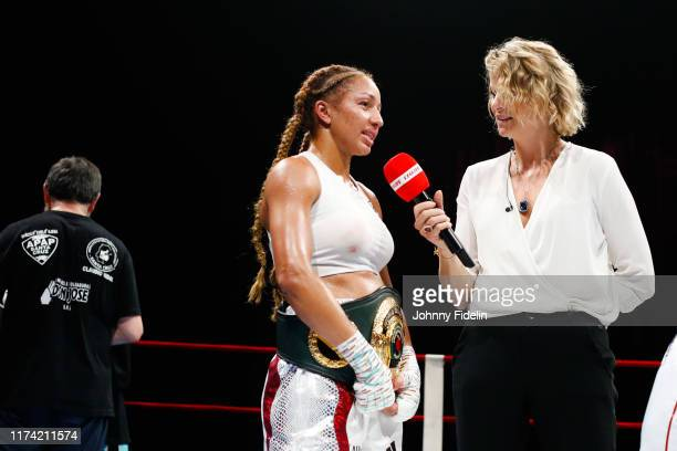 Estelle YOKA MOSSELY of France and France PIERRON journalist L'Equipe TV during the World Championship IBO at Casino Lucien Barriere on October 5...