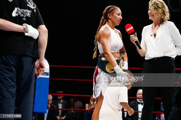 Estelle YOKA MOSSELY of France with his son Ali and France PIERRON journalist L'Equipe TV during the World Championship IBO at Casino Lucien Barriere...