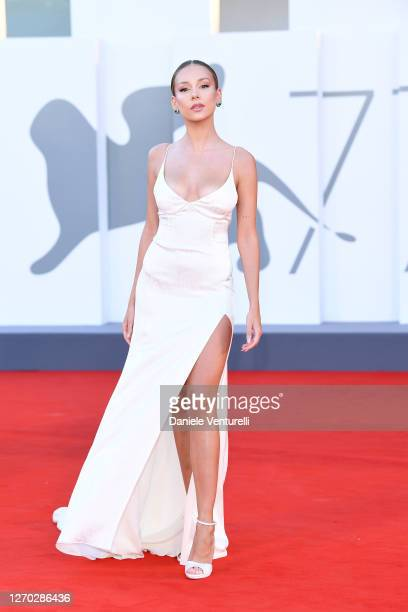 Ester Exposito walks the red carpet ahead of the Opening Ceremony and the Lacci red carpet during the 77th Venice Film Festival at on September 02...