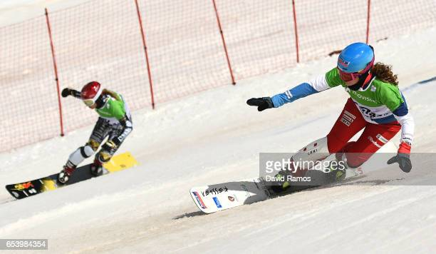 Ester Ledecka of the Czech Republic and Patrizia Kummer of Switzerland compete in the big final of the Women's Parallel Giant Slalom on day 9 of the...